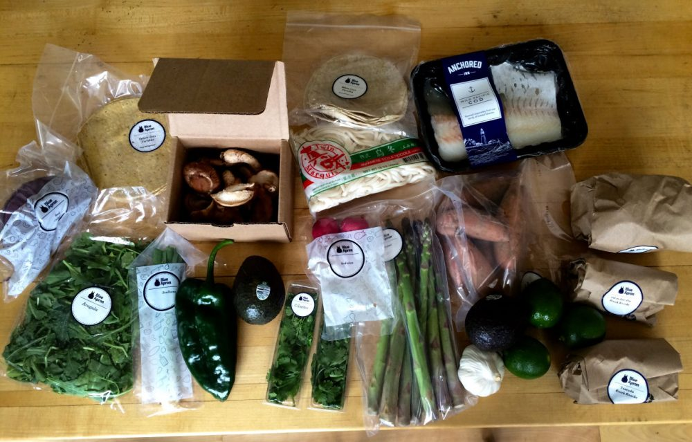 ngredients and packaging from a Blue Apron meal box for three meals. (Kathy Gunst/Here & Now)