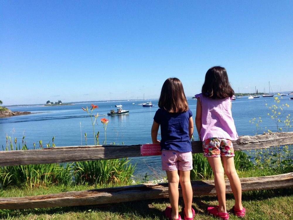 Laura Shea Souza writes that, for one week a year, a rented cottage on the Maine coast feels just like coming home. Pictured: The author's daughters overlooking the harbor in Biddeford, Maine, in 2014. (Author/Courtesy)