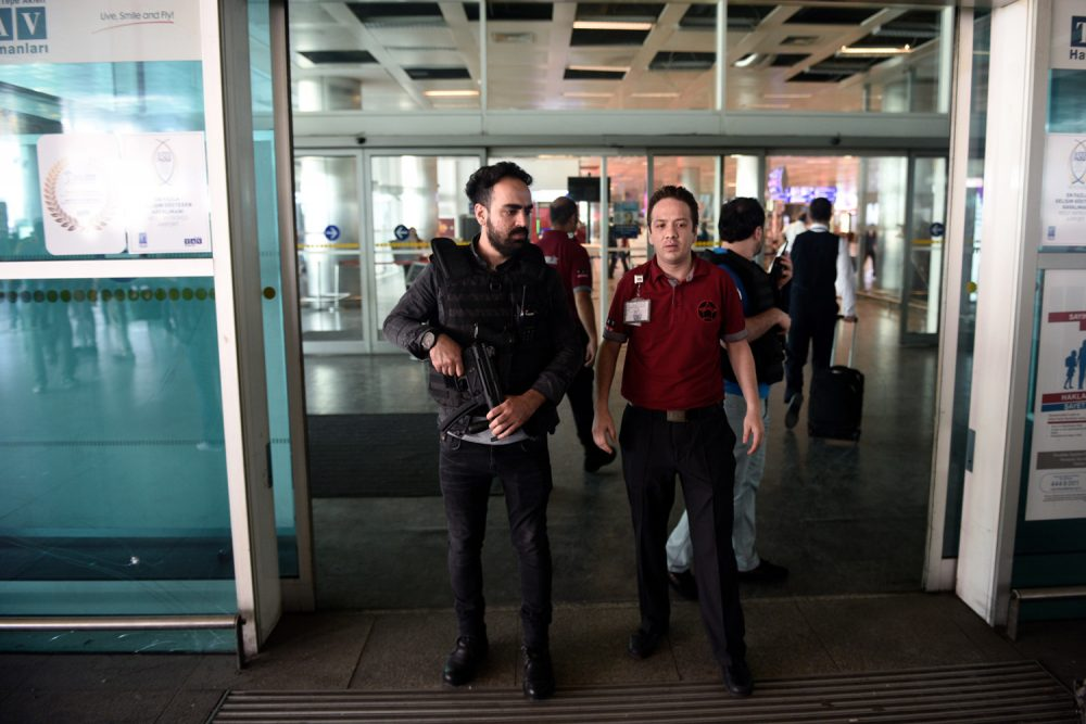 Security officials stand at an entrance of Ataturk Airport in Istanbul, Wednesday, June 29, 2016. (AP Photo)