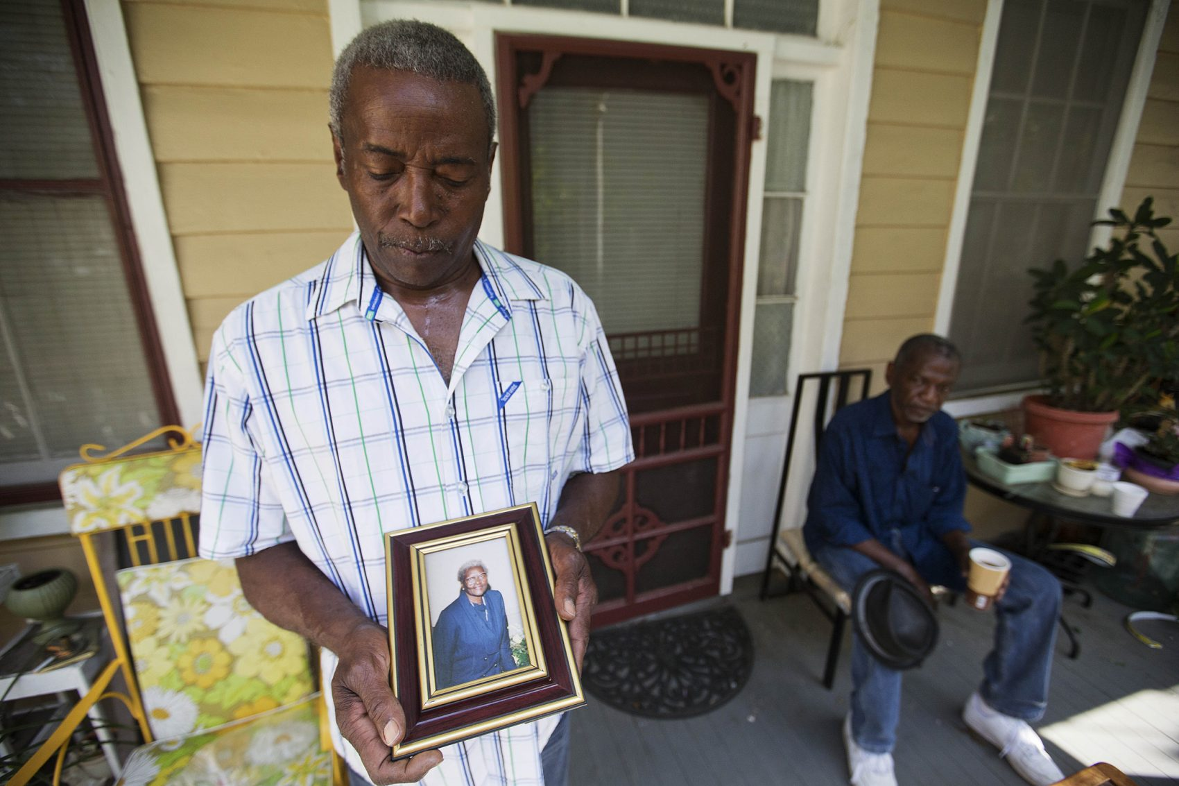 "Walter Jackson, left, holds a photo of his mother Susie Jackson, one of the nine people killed in a 2015 shooting at Emanuel AME Church. ""Right now all in my heart is anger for him,"" said Jackson. ""I doubt if I'll ever forgive him."" (David Goldman/AP)"