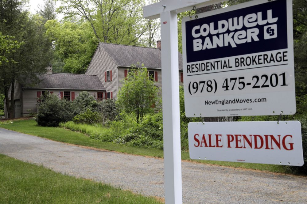 "This 2016 file photo shows a ""Sale Pending"" sign in front of a house in North Andover. (Elise Amendola/AP)"