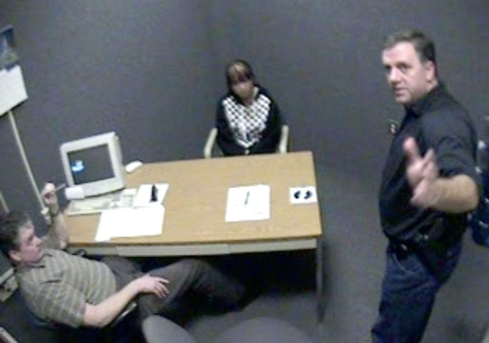 A screenshot of video footage attained by WBUR shows Worcester Police Sgt. Kevin Pageau, right, and Detective John Doherty as they interrogate Nga Truong, then 16, after the 2008 death of her baby boy.