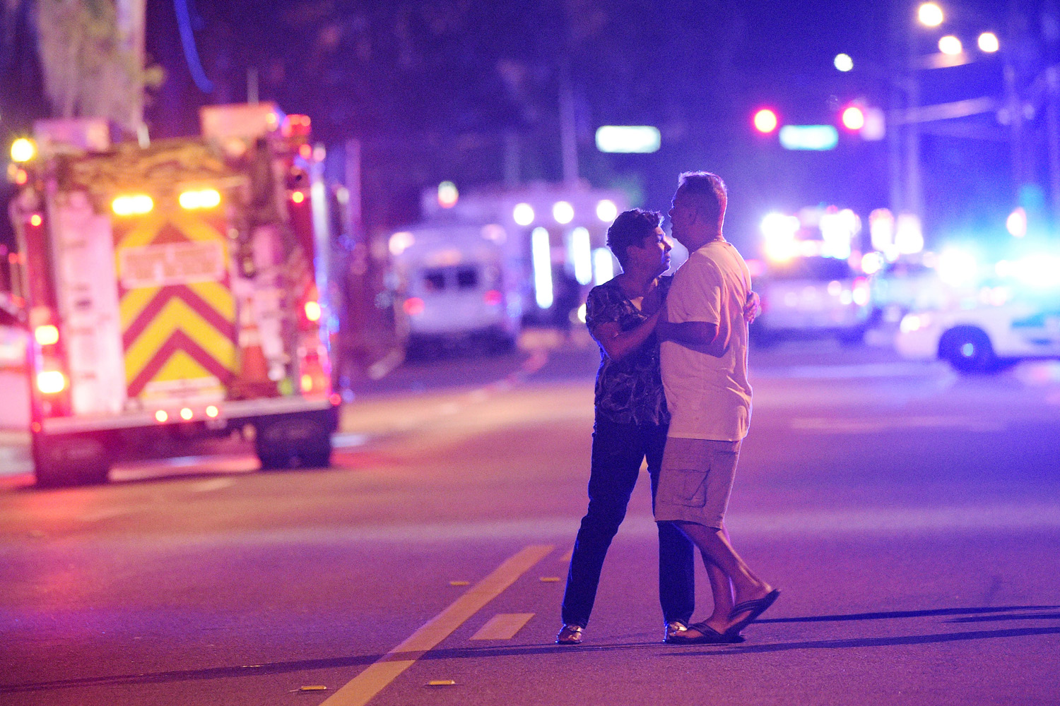 Family members wait for word from police after arriving down the street from a shooting involving multiple fatalities at Pulse Orlando nightclub in Orlando, Fla., Sunday, June 12, 2016. (Phelan M. Ebenhack / AP)