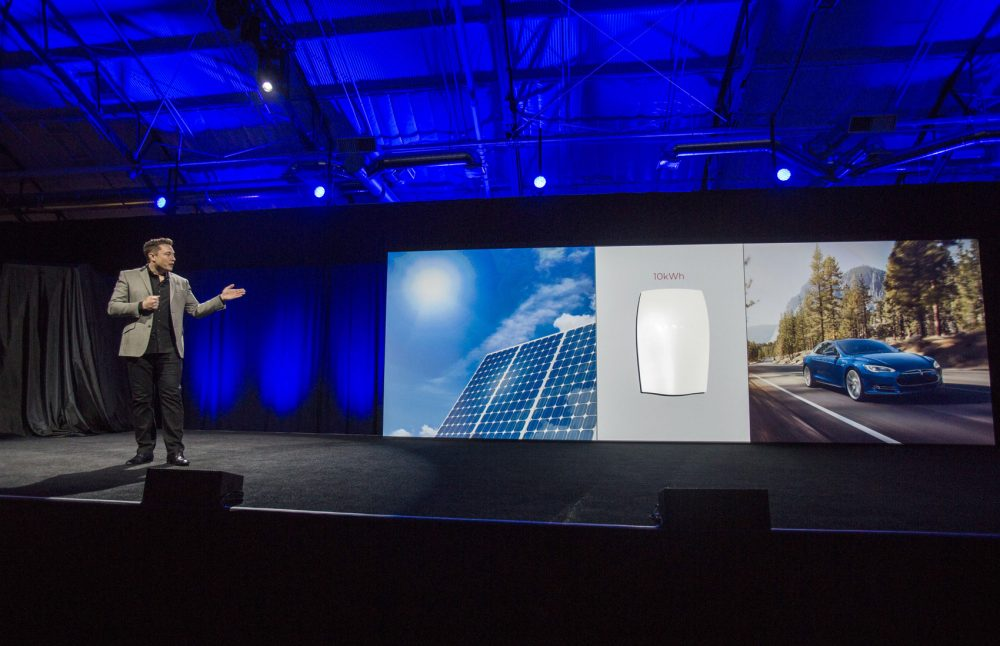 Elon Musk, CEO of Tesla Motors Inc., unveils the company's Powerwall home battery in April 2015. Vermont's largest utility is selling Tesla's Powerwall to its customers -- both for the homeowner's private use and for the utility to draw on as a source of electricity. Green Mountain Power is the first utility in the country to pilot the Powerwall in this way. (Ringo H.W. Chiu/AP)