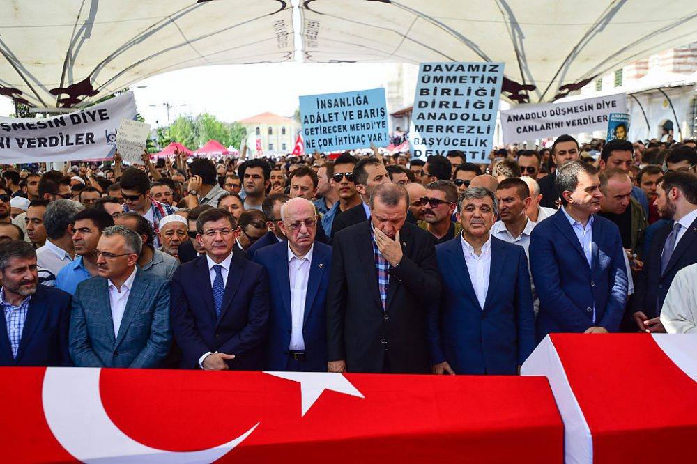 Former Turkish President Abdullah Gul (R), Turkish President Recep Tayyip Erdogan (2nd R), Turkey's Grand National Assembly President Ismail Kahraman (C) and former PM Ahmet Davutoglu attend the funeral service for victims of the thwarted coup in Istanbul at Fatih mosque on July 17, 2016 in Istanbul, Turkey. Clean up operations are continuing in the aftermath of Friday's failed military coup attempt which claimed the lives of more than 250 people. In raids across Turkey 6,000 people have been arrested in relation to the failed coup including high-ranking soldiers and judges, Turkey's Justice Minister Bekir Bozdag has said. (Burak Kara/Getty Images)