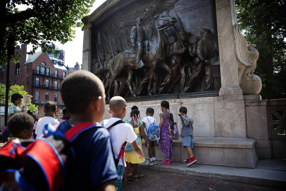 A group of elementary school students from Paige Academy in Roxbury approached the Shaw Memorial at the Boston Common. (Jesse Costa/WBUR)