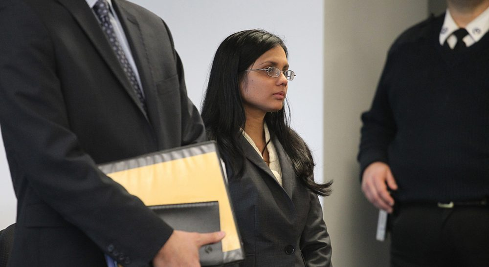 Former state lab chemist Annie Dookhan during an arraignment in 2013. She is in prison after pleading guilty to faking test results in thousands of cases. Since the crisis broke, Dookhan's actions have raised questions about the legitimacy of convictions. (Suzanne Kreiter, The Boston Globe/AP, Pool)