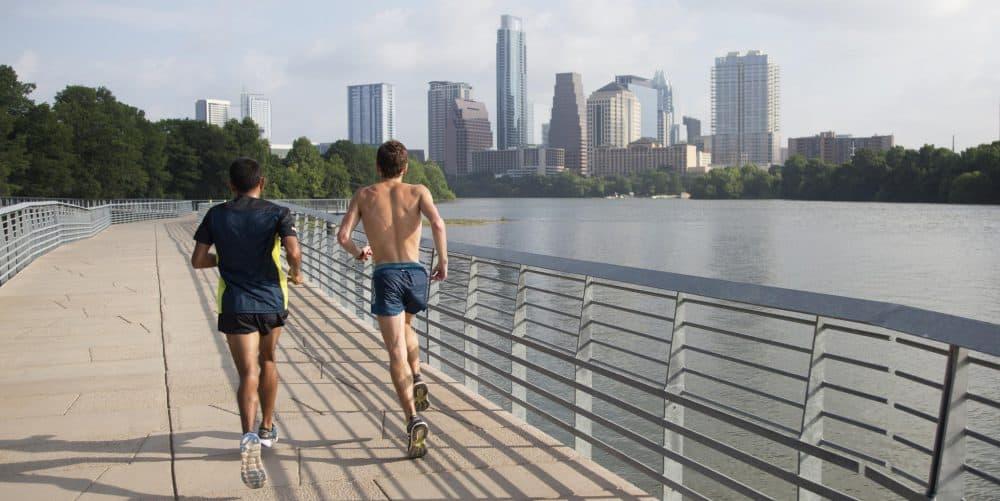 Leonel Manzano (left) runs the Lady Bird Lake Boardwalk with steeplechase hopeful Matt Cleaver. (Miguel Gutierrez Jr. / KUT)