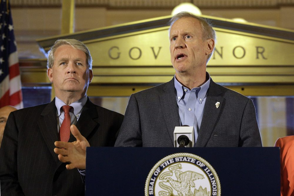 Illinois Gov. Bruce Rauner speaks to reporters in front of his office at the Illinois State Capitol, Thursday, June 30, 2016, in Springfield, Ill. Illinois lawmakers were moved to compromise on a stopgap budget after a year-and-a-half stalemate by a powerful force: a high-stakes November election and a voting public one legislator described as near revolt. (Seth Perlman/AP)