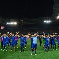 The Icelandic national football team celebrated with their fans following their stunning victory over England. (Dan Mullan/Getty Images)
