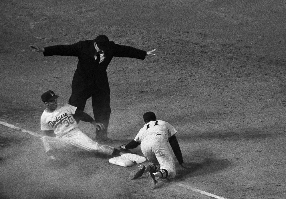 A familiar scene for Maury Wills, who was perhaps best-known for his prowess in stealing bases. (AP Photo)