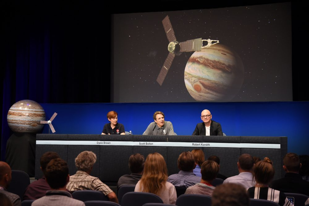 NASA Program Executive Diane Brown (L), Juno Mission Principal Investigator Scott Bolton (C) and Robert Kondrk (R), Apple vice president for Content and Media Apps, attend a press conference at the Jet Propulsion Laboratory (JPL) in Pasadena, California, June 30, 2016. (Robyn Beck/AFP/Getty Images)