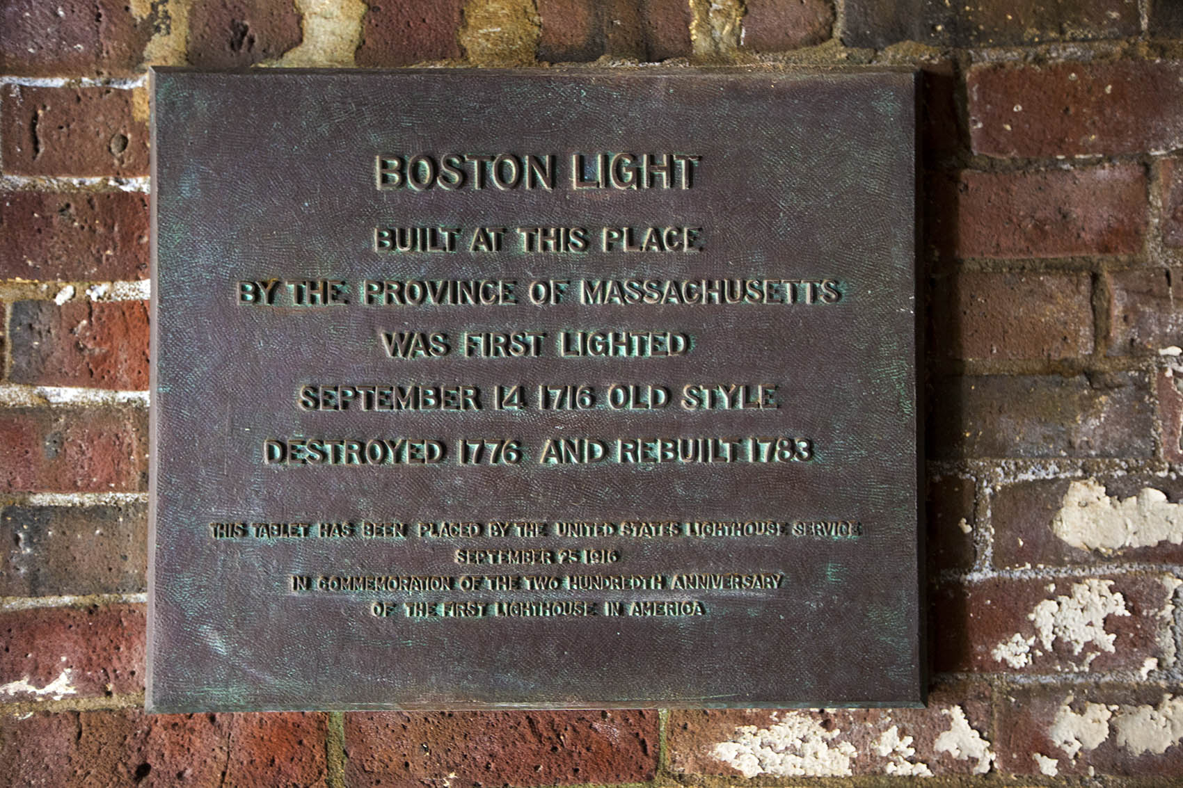 Plaque indicating when the original lighthouse was erected, destroyed and then rebuilt. (Jesse Costa/WBUR)