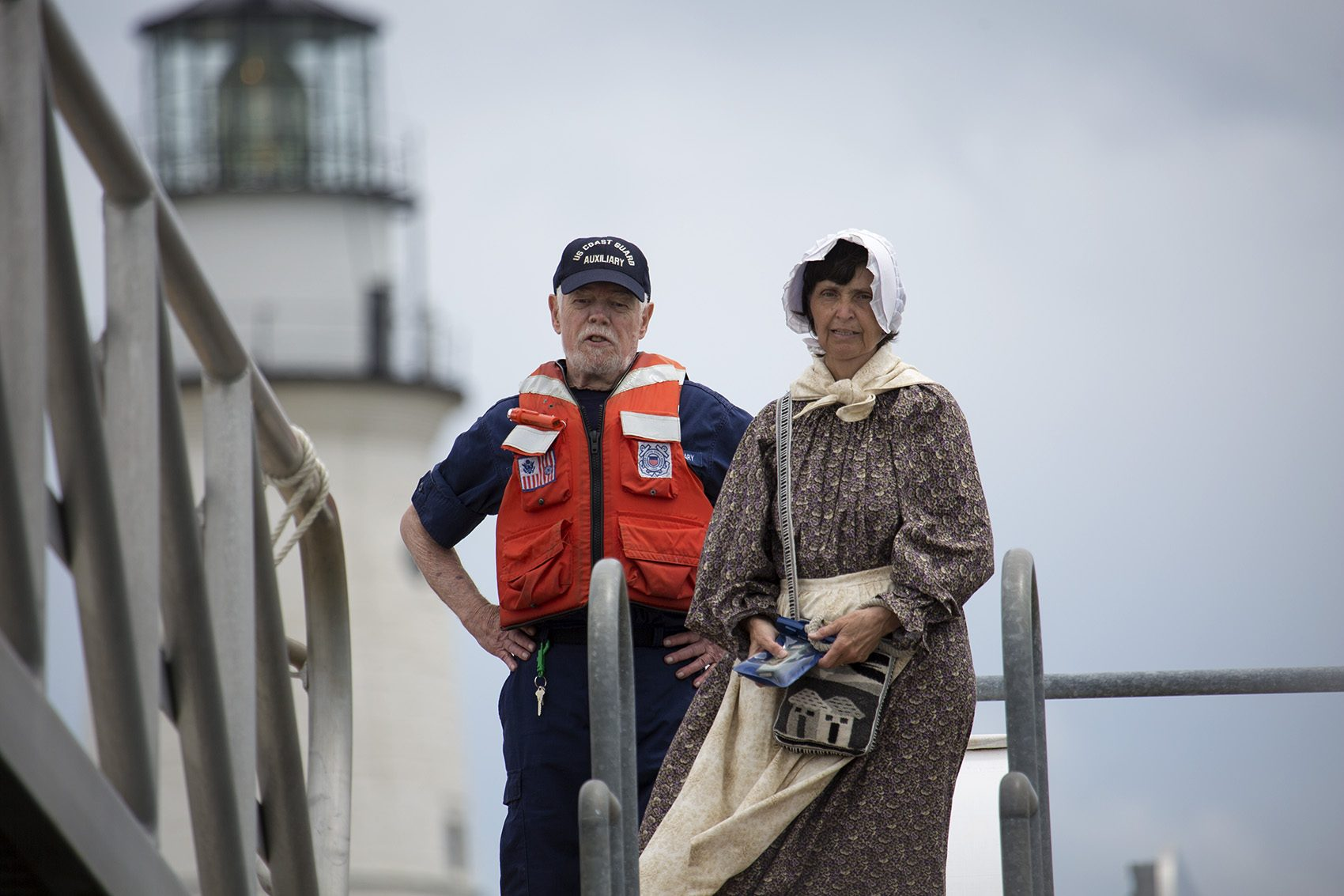 Sally Snowman and Coast Guard Auxiliary volunteer worker Hugh Daughtry at the dock at Little Brewster Island. (Jesse Costa/WBUR)
