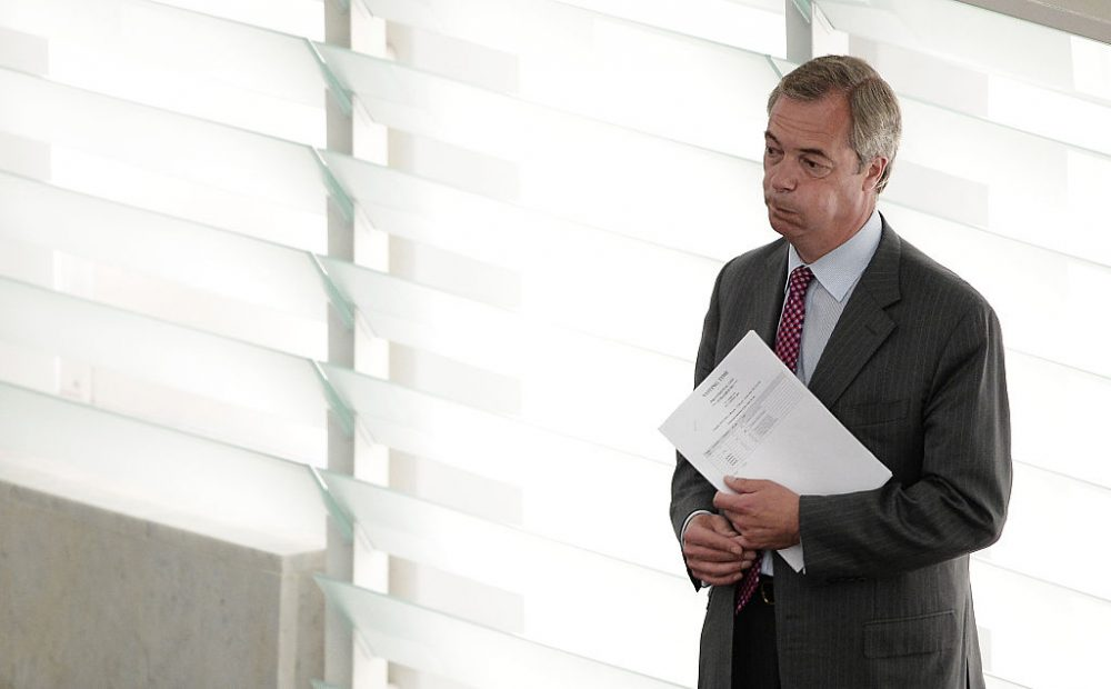 """Former leader of the United Kingdom Independence Party (UKIP) Nigel Farage reacts as he arrives for a voting session at the European Parliament during the monthly session at the EU Parliament in Strasbourg, on July 5, 2016. European Commission head Jean-Claude Juncker sharply criticized politicians Nigel Farage and Boris Johnson as the """"sad heroes"""" of Brexit who backed out of leading Britain through the EU exit they had campaigned for. """"Patriots don't resign when things get difficult, they stay,"""" he added.  (Frederick Florin /AFP/Getty Images)"""