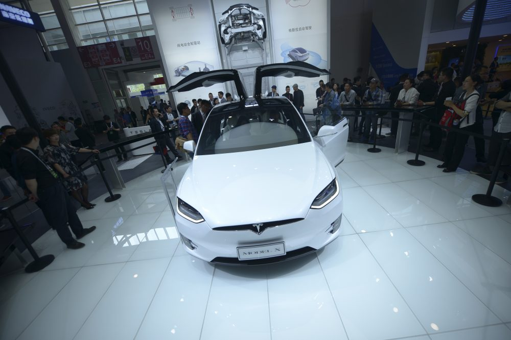 Vistors look at a Tesla Model X on display at the Beijing Auto Show in Beijing on April 25, 2016. Global carmakers gathered in Beijing on April 25 to show off their wares as competition intensifies and growth slows in the world's biggest auto market, with the key SUV and new energy vehicle sectors the focus of attention. (WANG ZHAO/AFP/Getty Images)