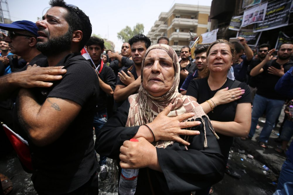 Iraqis beat themselves on the chest on July 6, 2016, as they mourn the victims of a suicide bombing that ripped through Baghdad's busy shopping district of Karrada on July 3. The Baghdad bombing claimed by the Islamic State group killed at least 250 people, officials said on July 6, raising the toll of what was already one of the deadliest attacks in Iraq. (AHMAD AL-RUBAYE/AFP/Getty Images)