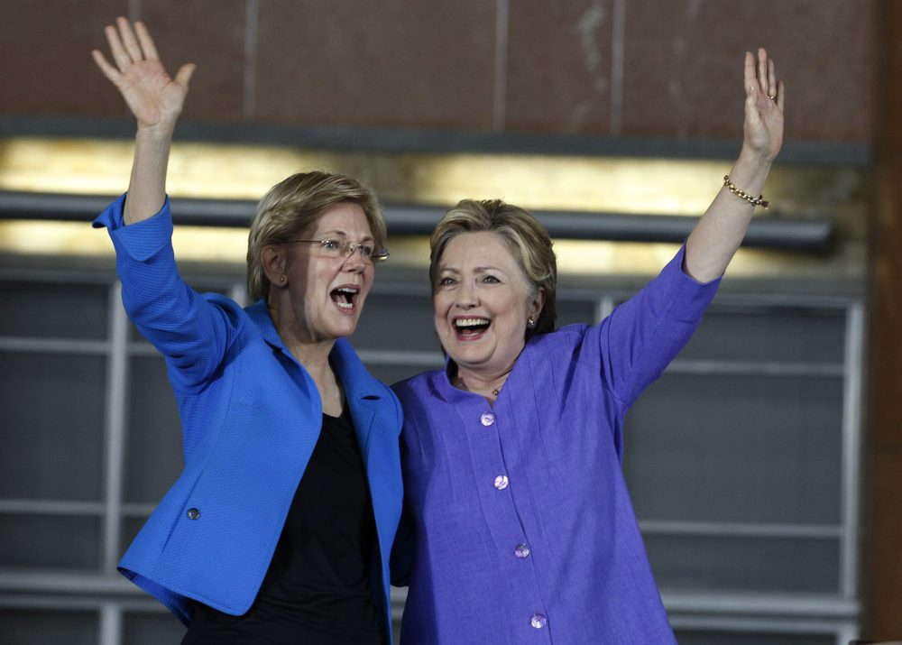 Democratic Presidential candidate Hillary Clinton (R) and U.S. Sen Elizabeth Warren (D-MA) wave to the crowd before a campaign rally at the Cincinnati Museum Center at Union Terminal June 27, 2016 in Cincinnati, Ohio. Warren is helping Clinton campaign in Ohio.   (John Sommers II/Getty Images)