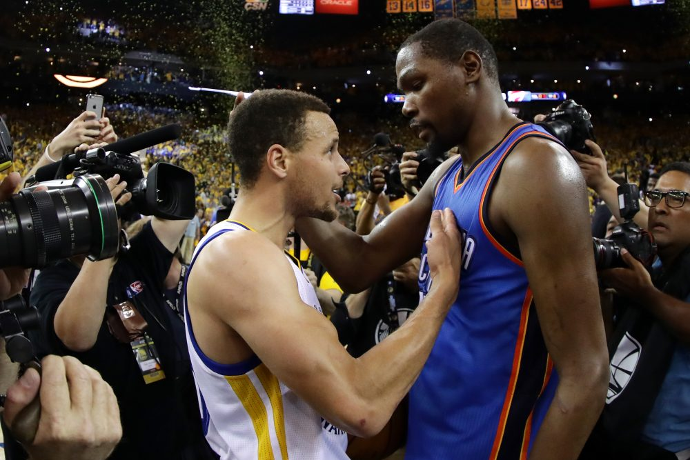 Kevin Durant (right) is joining Stephen Curry (left) on the Golden State Warriors. Durant and Curry have combined for the last three NBA MVP awards. (Ezra Shaw/Getty Images)