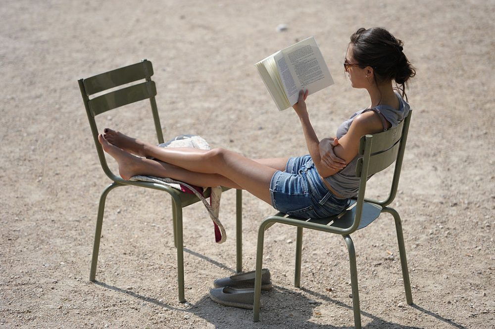 A woman reads a book under the sun in the Luxembourg gardens in Paris, on July 1, 2010. (Miguel Median/AFP/Getty Images)