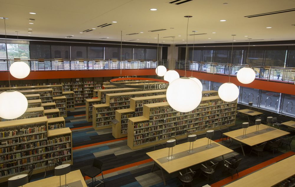 Alex Green writes that this is the library that Boston has lacked for generations, and one that should be treasured for generations to come. Pictured: The Boston Public Library's new fiction section. (Joe Difazio for WBUR)