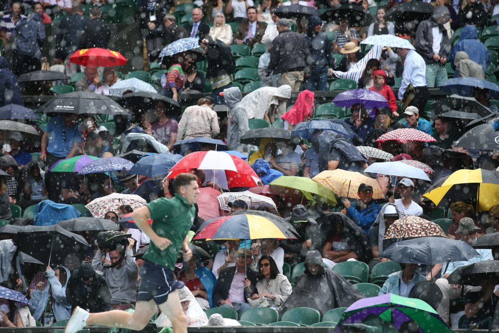 Rain majorly derailed the first week of Wimbledon, forcing the All England Club to open its gates on middle Sunday. ( Justin Tallis/AFP/Getty Images)