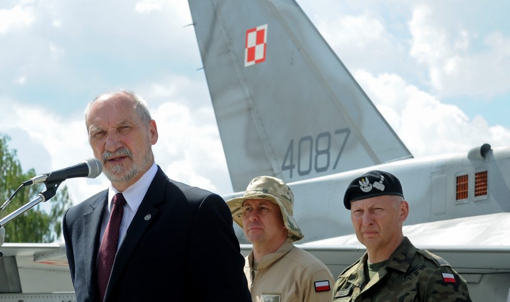 Polish Defense Minister Antoni Macierewicz speaks in front of a Polish Air Force F-16 fighter jet during a farewell ceremony of Polish soldiers leaving for Kuwait to take part in the operation Inherent Resolve, in Janow, Poland, Monday, July 4, 2016. (Alik Keplicz/AP)