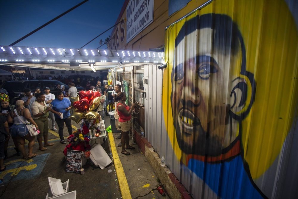 Protesters gather in front of a mural painted on the wall of the convenience store where Alton Sterling was shot and killed, July 6, 2016 in Baton Rouge, Louisiana. Sterling was shot by a police officer in front of the Triple S Food Mart in Baton Rouge on Tuesday, July 5, leading the Department of Justice to open a civil rights investigation. (Mark Wallheiser/Getty Images)