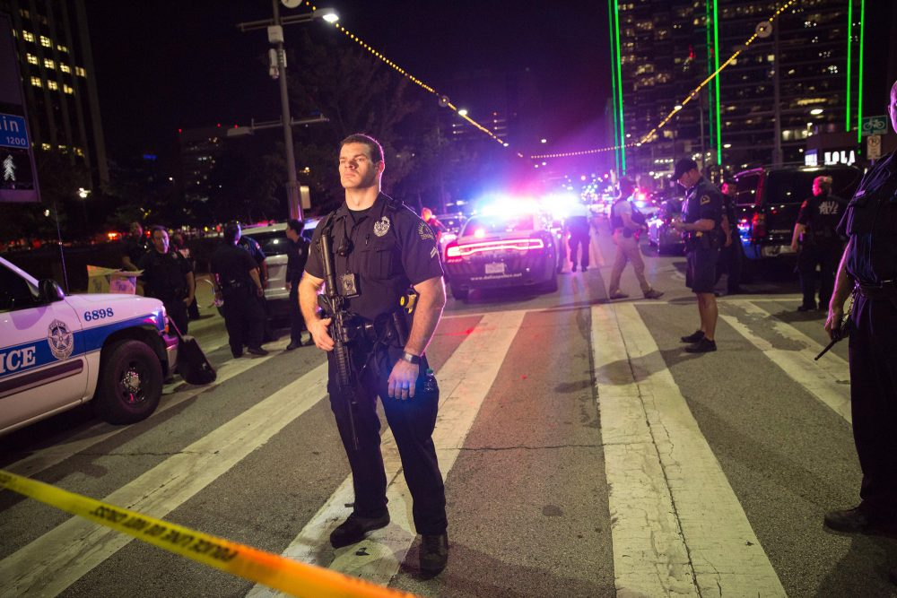 Police officers stand guard at a baracade following the sniper shooting in Dallas on July 7, 2016. (Laura Buckman/AFP/Getty Images)