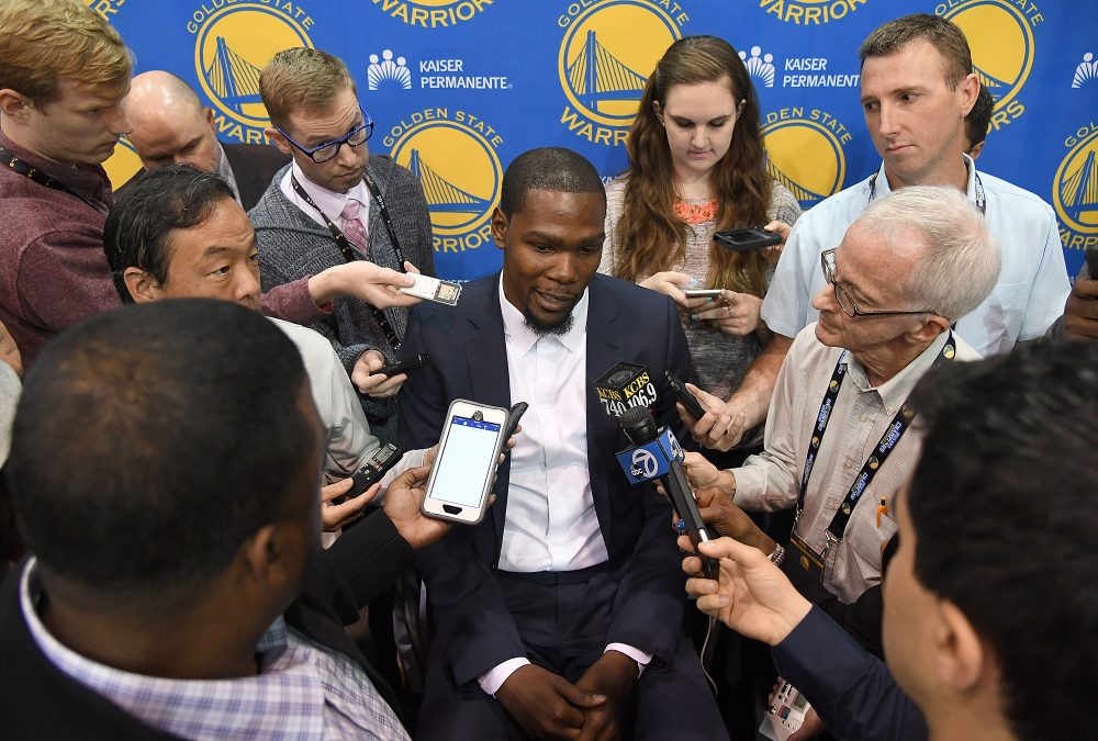 The constant media attention to Kevin Durant and his free agency decision to join the rival Golden State Warriors is one of many off-court storylines the NBA is generating. (Thearon W. Henderson/Getty Images)