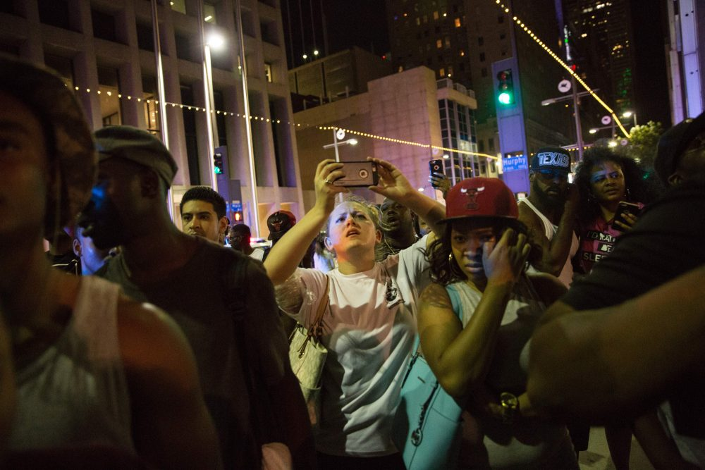 Protestors yell after police officers arrest a bystander following the shooting at a protest in Dallas on July 7, 2016. (Laura Buckman/Getty Images)