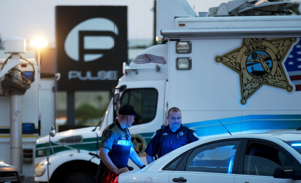 In this June 17, 2016 file photo, law enforcement officials stand outside the Pulse nightclub following the mass shooting, in Orlando, Fla. (David Goldman/AP)