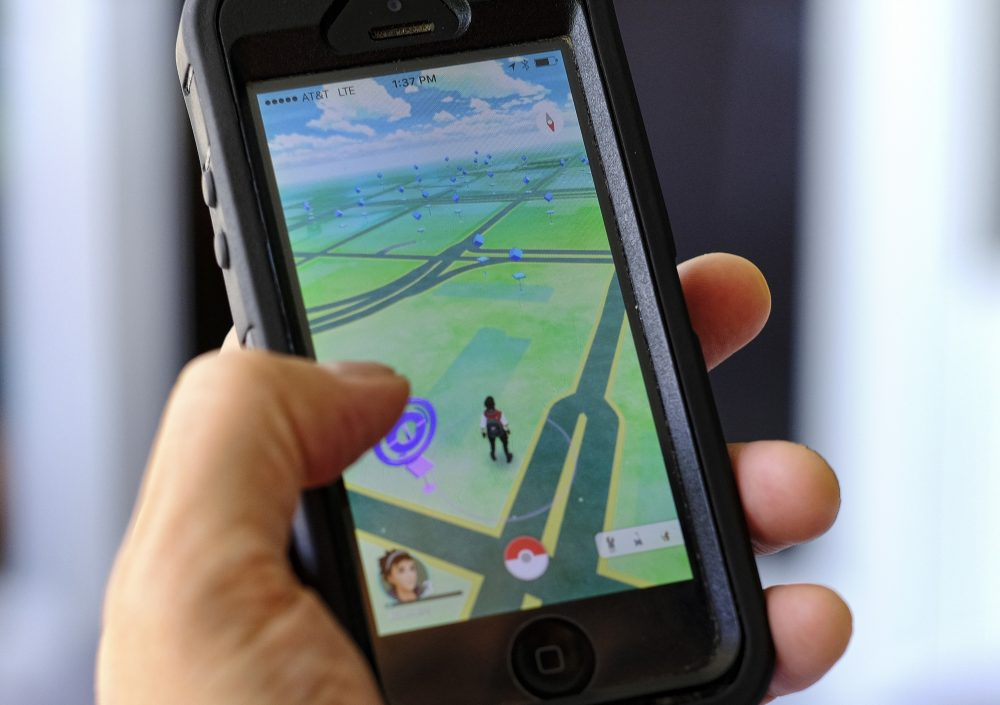 Pokemon Go is displayed on a cell phone in Los Angeles on Friday, July 8, 2016. Just days after being made available in the U.S., the mobile game Pokemon GO has jumped to become the top-grossing app in the App Store. (Richard Vogel/AP)