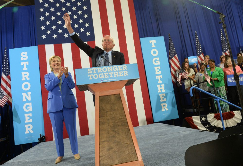 Bernie Sanders campaigns with presumptive Democratic presidential nominee Hillary Clinton at Portsmouth High School July 12, 2016 in Portsmouth, New Hampshire. Sanders endorsed Clinton for president of the United States. (Darren McCollester/Getty Images)