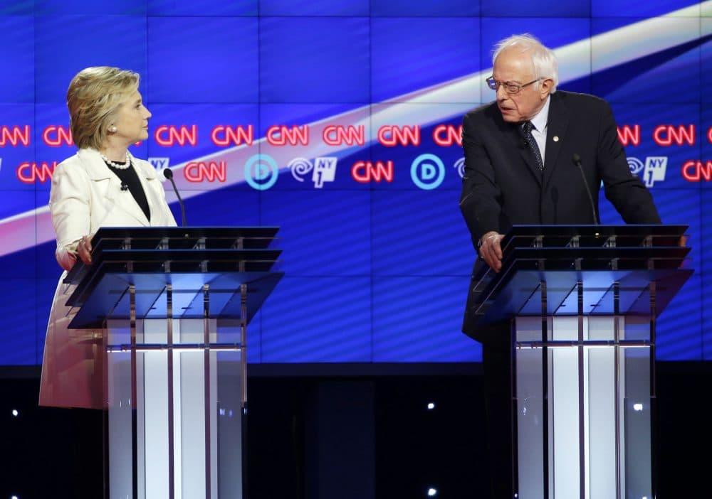 Democratic presidential candidates Sen. Bernie Sanders, I-Vt., right, and Hillary Clinton speak during the CNN Democratic Presidential Primary Debate at the Brooklyn Navy Yard in April in New York. (Seth Wenig/AP)
