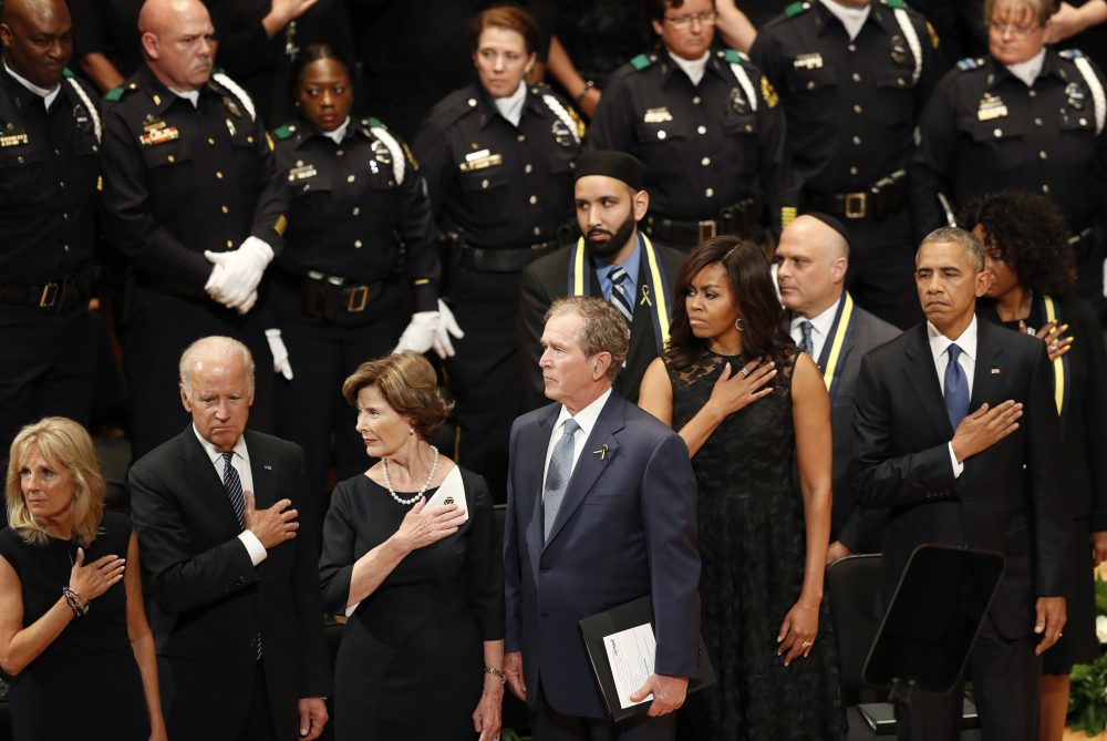 President Barack Obama, right, stands with first lady Michelle Obama, and former President George W. Bush, center, and Barbara Bush, during a memorial service at the Morton H. Meyerson Symphony Center with the families of the fallen police officers, Tuesday, July 12, 2016, in Dallas. Five police officers were killed and several injured during a shooting in downtown Dallas last Thursday night. (Eric Gay/AP)