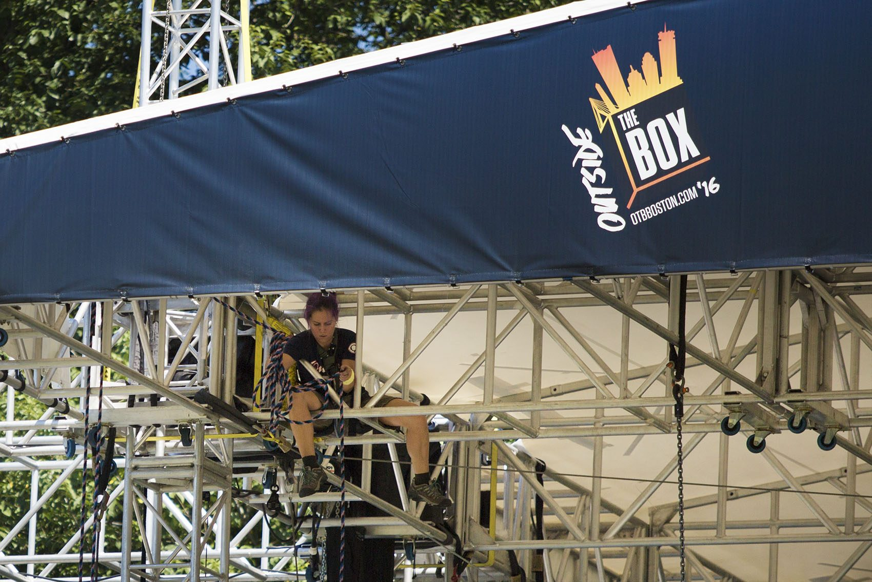 A worker prepares one of the venues on the Boston Common for the Outside The Box Festival. (Jesse Costa/WBUR)