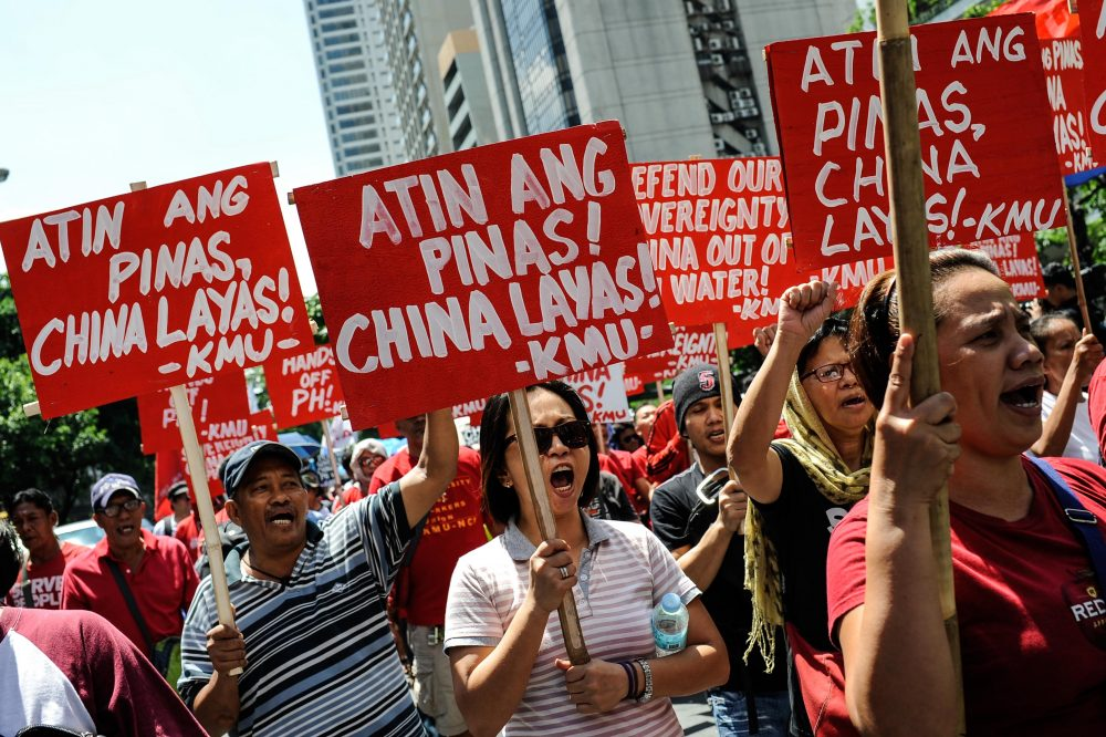Anti-China protesters mount a rally against China's territorial claims in the Spratlys group of islands in the South China Sea in front of the Chinese Consulate on July 12, 2016 in Makati, Philippines. (Dondi Tawatao/Getty Images)