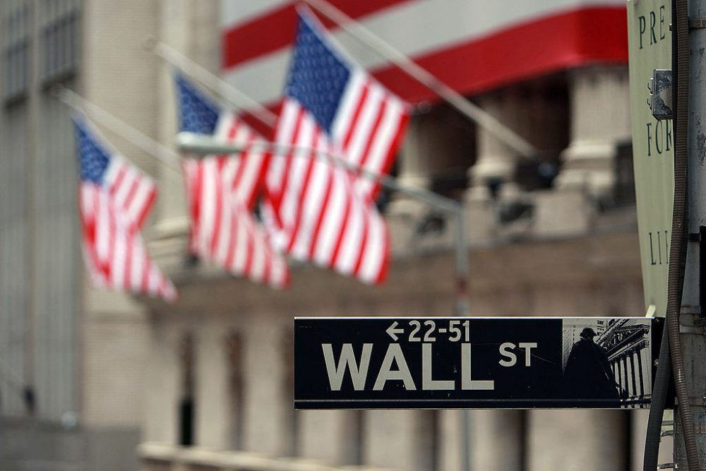 A Wall St. sign next to the New York Stock Exchange (NYSE) September 16, 2008 in New York City. (Spencer Platt/Getty Images)