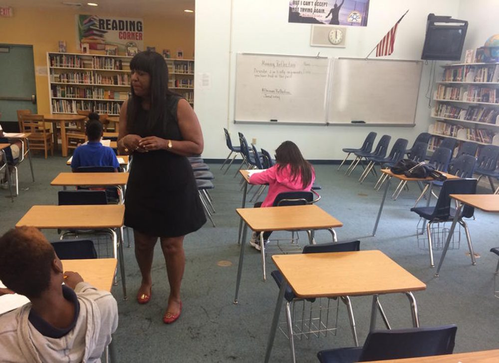 """Students complete self-reflection surveys at the success center at 500 Rolemodels academy. A prompt on the whiteboard says: """"Describe 2 or 3 silly arguments you have had in the past."""" (Rowan Moore Gerety/WLRN)"""