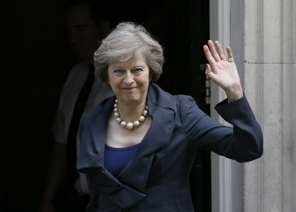 Britain's Home Secretary Theresa May waves towards the media as she arrives to attend a cabinet meeting at 10 Downing Street, in London, Tuesday, July 12, 2016. (Kirsty Wigglesworth/AP)