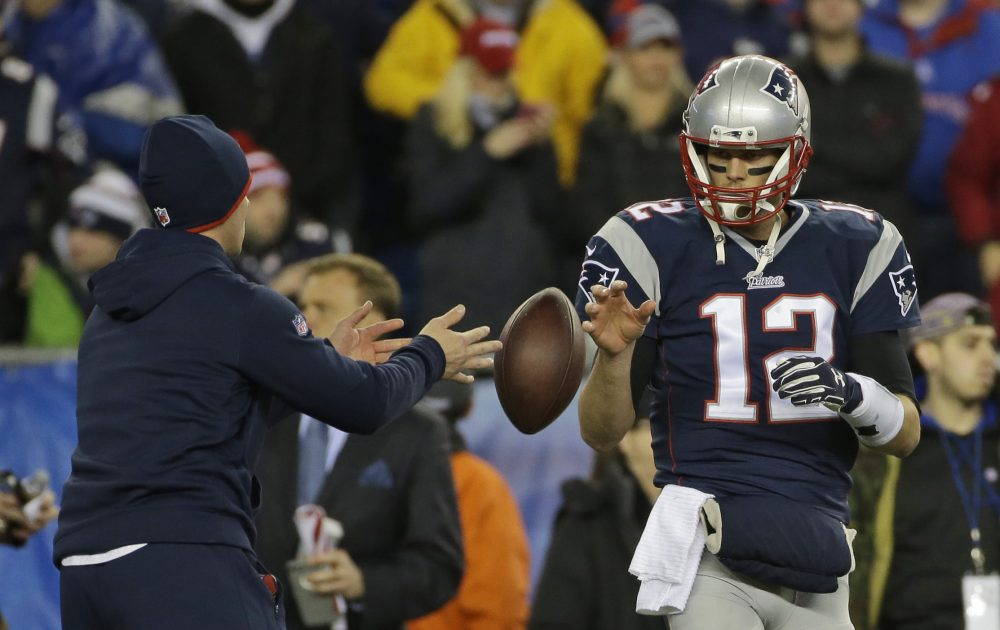 New England Patriots quarterback Tom Brady has a ball tossed to him during warmups before the NFL football AFC Championship game against the Indianapolis Colts in Foxborough, Mass. in 2015. (Matt Slocum/AP)