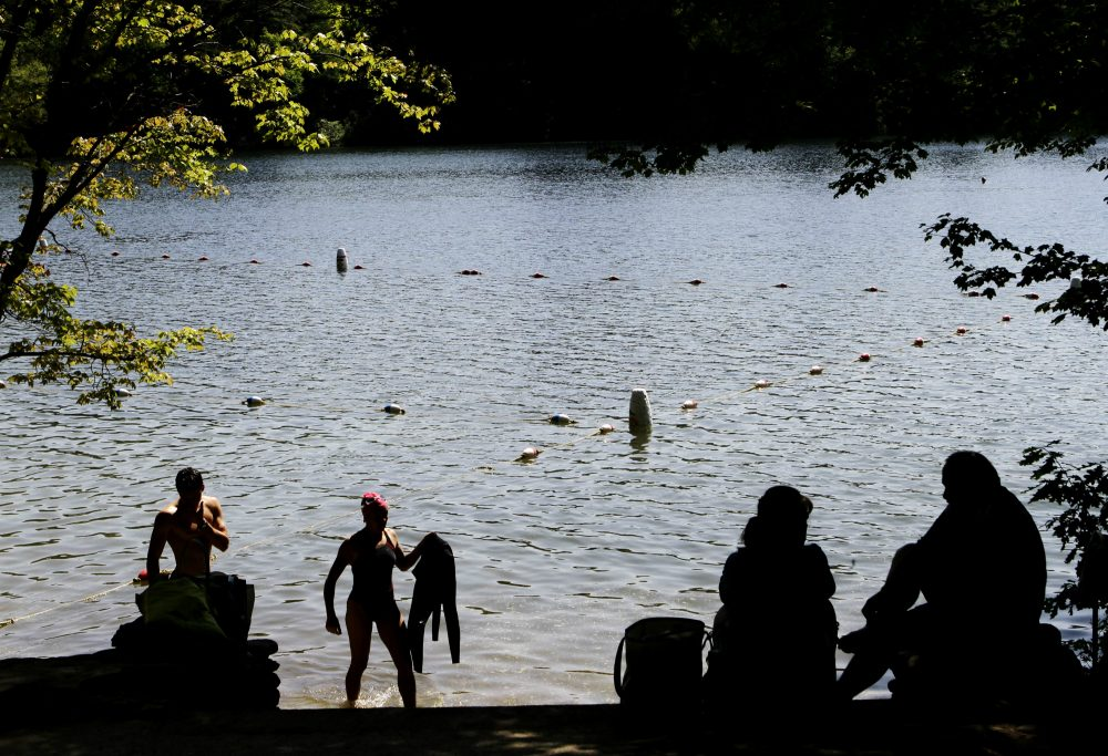 A swimmer steps out of the water at the edge of Walden Pond, in Concord, Mass. in this May, 26, 2010 photo. (Steven Senne/AP)