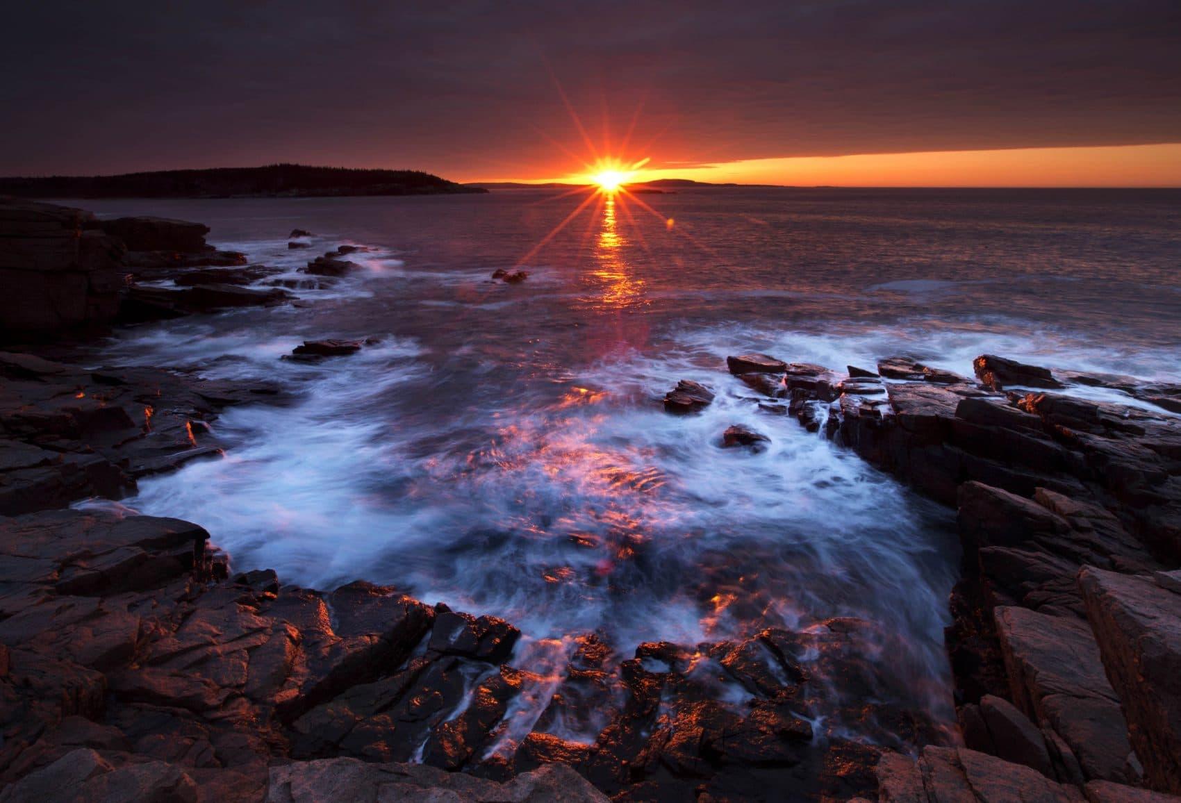 The sun's rays strike the rocky coast of Acadia National Park, in Maine, Thursday, May 2, 2013. (Robert F. Bukaty/AP)
