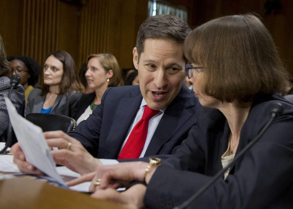 """Centers for Disease Control and Prevention Director Tom Frieden, left, confers with State Department Bureau of Oceans and International Environmental and Scientific Affairs Acting Assistant Secretary Judith Garber, on Capitol Hill in Washington, Wednesday, July 13, 2016, as they wait to testify before the Senate Foreign Relations subcommittee hearing on the """"Zika in the Western Hemisphere: Risks and response."""" (Manuel Balce Ceneta/AP)"""