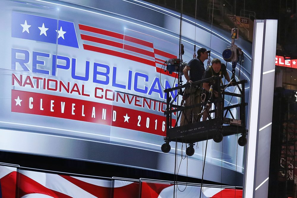 The main stage on the convention floor at the Quicken Loans Arena in downtown Cleveland, Ohio, is prepared for the upcoming Republican National Convention, as workers stand in a man lift on Wednesday, July 13, 2016. (Gene J. Puskar/AP)
