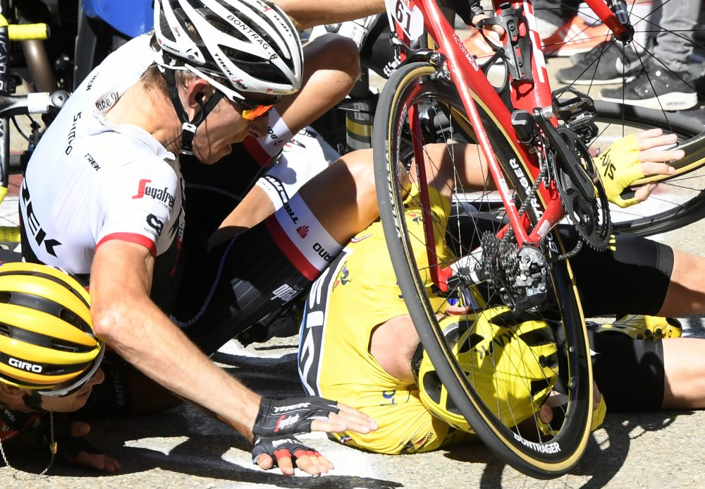 Britain's Chris Froome, wearing the overall leader's yellow jersey, right, Netherlands' Bauke Mollema, center, and Australia's Richie Porte crash at the end of the twelfth stage of the Tour de France cycling race in Mont Ventoux, France, Thursday, July 14, 2016. (Bernard Papon/Pool Photo via AP)