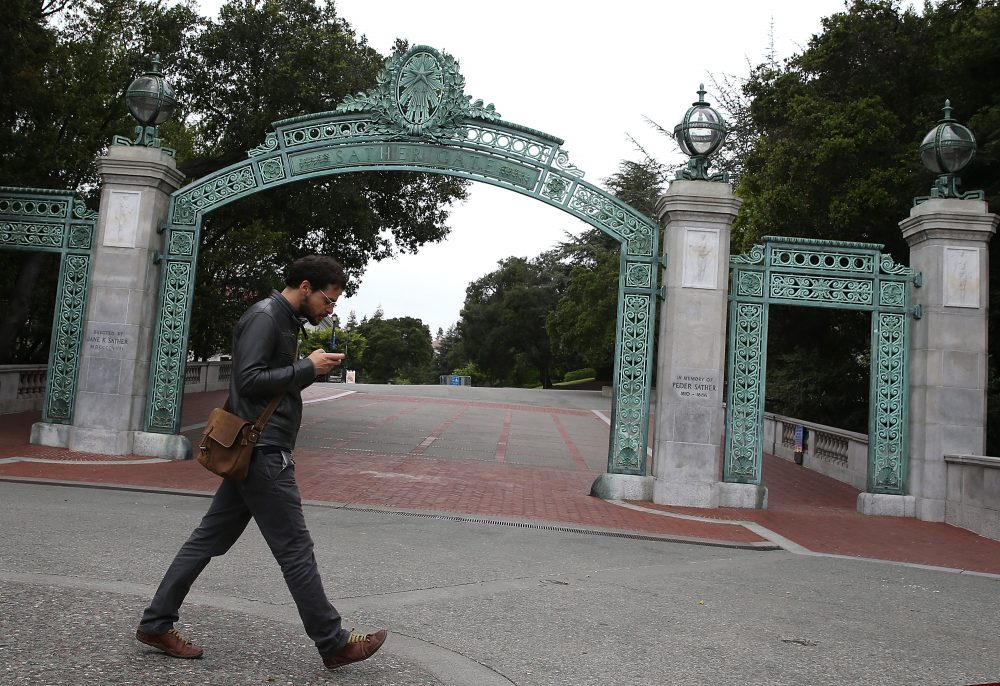 A pedestrian walks by Sather Gate on the UC Berkeley campus on May 22, 2014 in Berkeley, California. (Justin Sullivan/Getty Images)