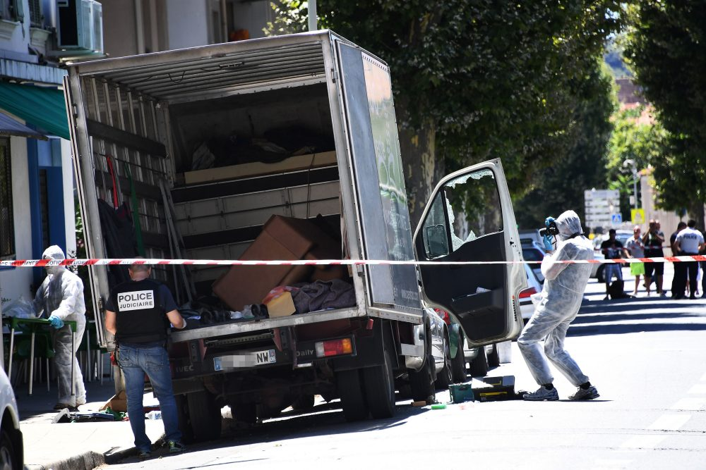 French police officers search a truck in a street of Nice on July 15, 2016, near the building where the man who drove a truck into a crowd watching a fireworks display the day before reportedly lived. (Anne-Christine Poujoulat/AFP/Getty Images)