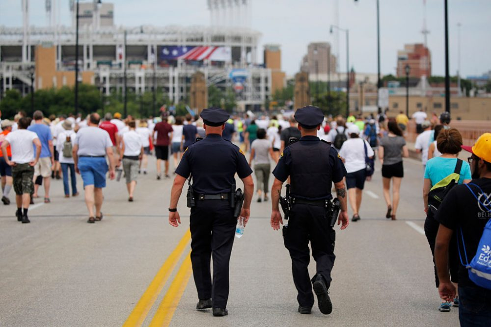 Police officers walk among people marching to join hands in a peace rally amid preparations for the arrival of visitors and delegates for the Republican National Convention on July 17, 2016, in Cleveland, Ohio. (Dominick Reuter/AFP/Getty Images)